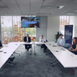 Leaders in Greater Manchester gather around a table to debate digital health