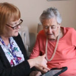 The Safe Steps app being used by two women in a care home