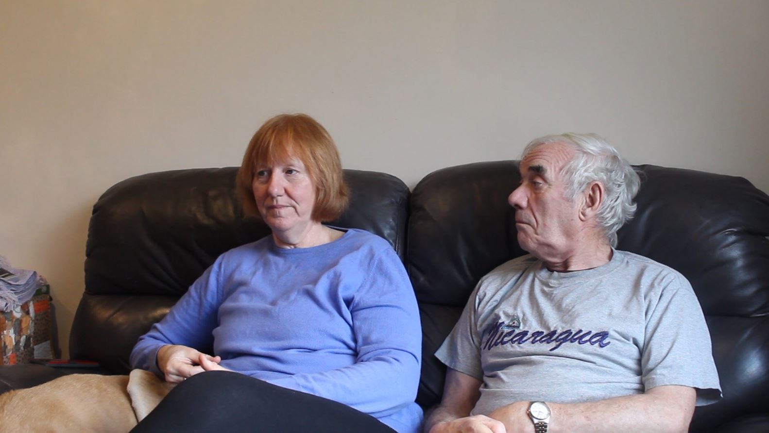 Liz and Mike Brookes sat side by side, at home in Rochdale.