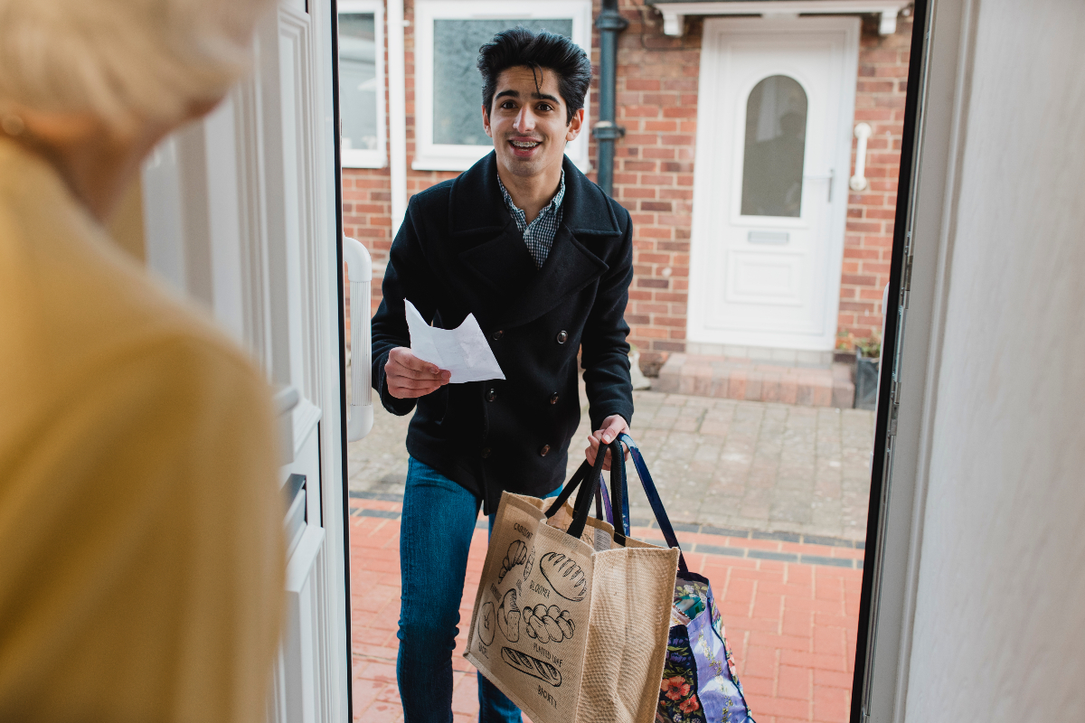 NHS Volunteer delivers food shopping to a home