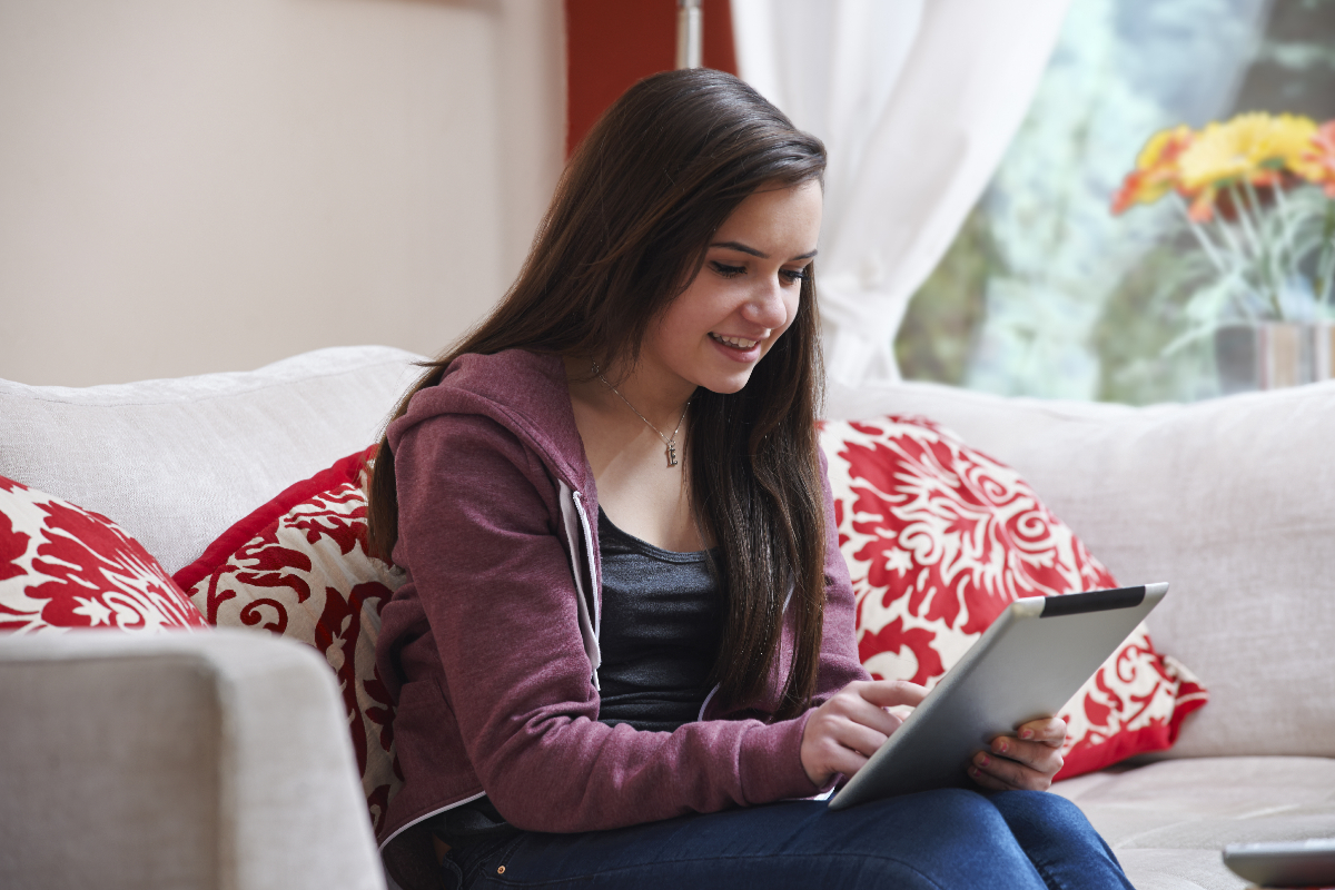 Teen girl using tablet