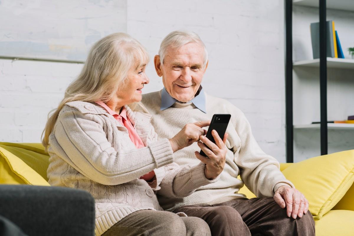 Elderly couple using app on mobile phone
