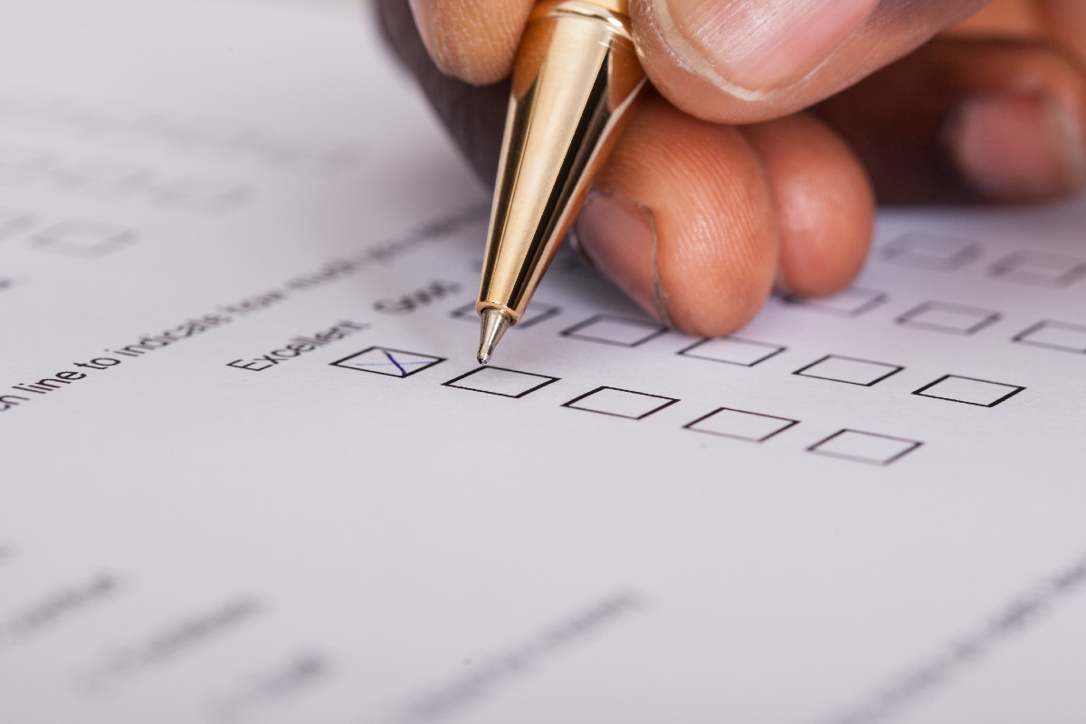 Person holding a pen filing in a survey
