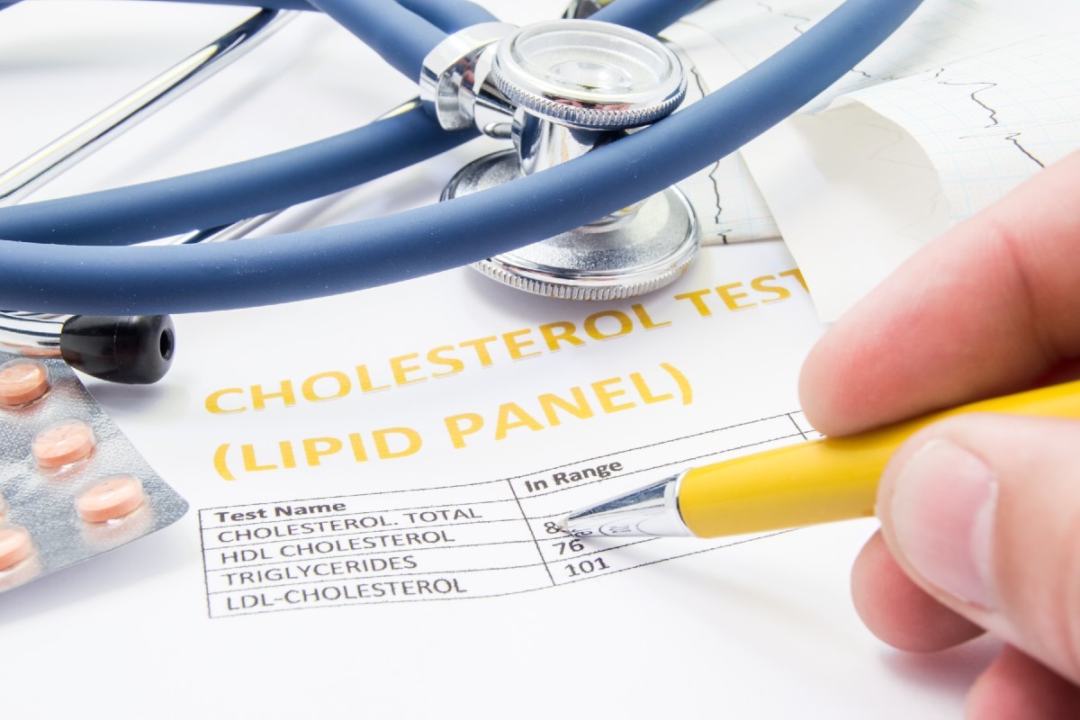 Medical professional reviewing cholesterol lipid panel results
