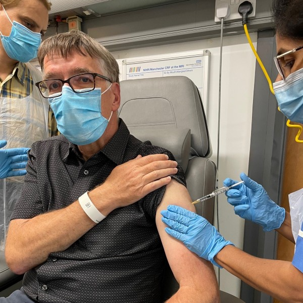 Andrew Clarke receiving the first COVID-19 multivariant vaccine booster as part of a trial at Manchester University NHS Foundation Trust