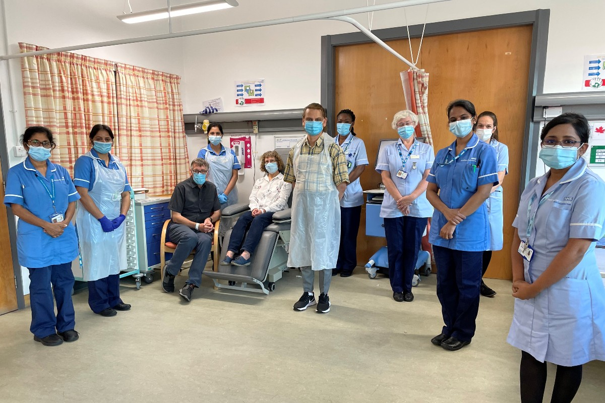 Andrew and Helen Clarke with members of the clinical trials team at the mulitvariant COVID-19 Vaccine Booster trial at Manchester University NHS Foundation Trust